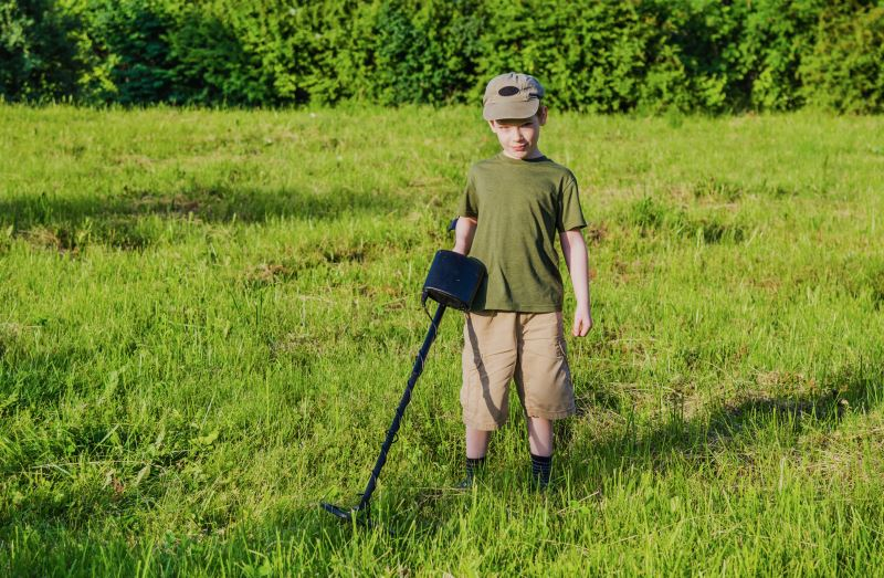 Boy metal detecting